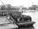 Crowded barge docking at Nome waterfront, June 9, 1906