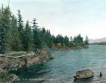 Coast line with trees, building and covered boat near Ketchikan Alaska , Assorted Alaska...