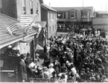 Crowd in Nome street attending July 4 public reading event, July 4, 1914