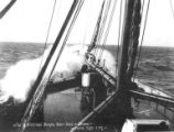 Midship view towards bow of steamer S.S. VICTORIA advancing into waves, Nome, circa 1907-1918