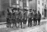 Army soldiers in formation in street, Nome, circa 1918