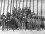 Men in work clothes posing with tools in front of completed caisson, Nome, circa 1905