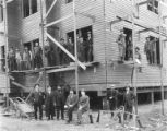 New courthouse under construction with carpenters and businessmen, Nome, July 24, 1908