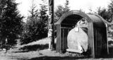 Eight foot spruce log and totem pole, Canadian National Railway Park, Prince Rupert, British...