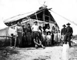 Nenena tribe Chief Thomas with group in front of dwelling, Alaska, ca. 1915.