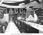 Tables set for Christmas banquet given to Aleut natives of Saint Paul Island by the North American...