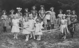 Group of children in costumes, possibly at an Easter or May Day celebration, Sitka, Alaska, circa...
