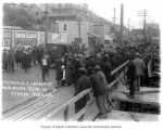 Crowd of people viewing automobile accident, Juneau, 1915