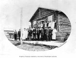 Senatorial party standing in front of the Arctic Brotherhood Hall, Rampart, July 1903