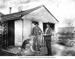 Edwin H. and John W. Pomeroy outside their home at Eagle, August 16, 1902