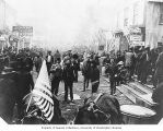 Possible July 4th celebration on Front Street showing American flags and businesses, Nome, ca. 1902