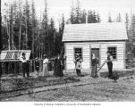 Family group posed in front of dwelling, possibly the McPhearson residence, Seward, n.d.