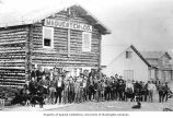 Men and dogs outside McQuesten and Company trading post, Circle, ca. 1895