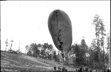 "Dirigible balloon """"Alaska Yukon Pacific Exposition"""" taking flight, Alaska..."