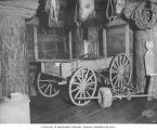 Pioneer wagon and farm tools display, Forestry Building, Alaska-Yukon-Pacific-Exposition, Seattle,...