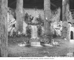 Wildlife scene with waterfall, deer, birds and other small animals, Forestry Building,...
