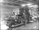 AlaPrinting press operators in the Alaska-Yukon-Pacific Exposition Daily News printing office,...