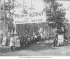 Prince Albert the Educated Horse exhibit, with a line of posed school children,...