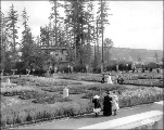 Formal Gardens with the Young Women's Christian Association Building in the background, Alaska...