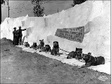 Caribou Bill with his dog team at the Eskimo exhibit, Alaska Yukon Pacific Exposition, Seattle,...