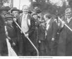 A.Y.P.E. President J.E. Chilberg holding a shovel at the groundbreaking ceremony, with Washington...