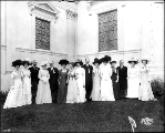 Exposition officials, Oregon delegates, and Portland Hostesses standing outside the Oregon...