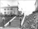 Eskimo woman named Nancy Columbia in fur parka posing on the steps of the Administration Building,...