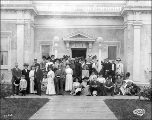 Group posing in front of the Masonic Building on Tacoma Day, Alaska Yukon Pacific Exposition,...