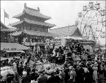 Chinese Village during a parade, with Ferris wheel to the right, Pay Streak,  Alaska-Yukon-Pacific...