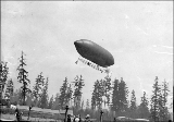 "Dirigible balloon """"Alaska Yukon Pacific Exposition"""" in flight, Alaska Yukon..."