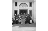 Alaska-Yukon-Pacific Exposition Daily News staff posing on the steps of the Daily News Building,...