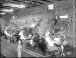 Linotype operators and machines in the Alaska-Yukon-Pacific Exposition Daily News printing office,...