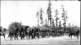 Exhibition cavalry drill at the military athletic tournament, Alaska Yukon Pacific Exposition,...