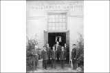 Officials and staff at the entrance of the Philippine Islands Building, Alaska Yukon Pacific...