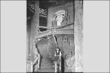 Girl in Native American clothing standing beneath official emblem, Forestry  Building interior,...