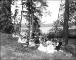 Visitors enjoying a picnic on the grounds of the Alaska Yukon Pacific Exposition, Seattle,...