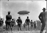 "Dirigible balloon """"Alaska Yukon Pacific Exposition"""" in flight over the..."