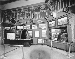 Hunting trophies, scenic photographs and other exhibits inside the Grand Trunk Railway Building,...
