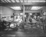 Olympia High School students working in the model kitchen and workshop areas in the Educational...