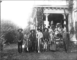 Caroline Burke and friends posed for group portrait with Native Americans outside her home,...