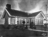 American Woman's League Building illuminated at night, Alaska Yukon Pacific Exposition, Seattle,...