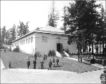 Philippine Islands Building, with officials and military personnel posing on the lawn, Alaska...