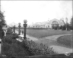 Formal gardens with Manufactures Building at right, Alaska Yukon Pacific Exposition, Seattle, 1909.