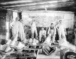 Skilled laborers and plasterers with some of their ornamental work during construction,...