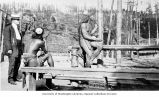 Two Igorrote men with one visitor man to the Igorrote village, Alaska-Yukon-Pacific-Exposition,...