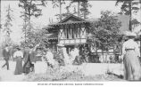 Hoo-Hoo House with visitors in foreground, Alaska-Yukon-Pacific-Exposition, Seattle, Washington,...