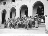 Group of men and women standing on the steps of the California State Building,...