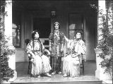 Caroline Burke and friends dressed in Native American costume on the porch of her home, Seattle,...
