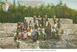 Igorotte men and women standing on a tiered rock wall, Igorotte Village,...