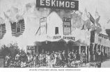 Eskimo Village main entrance, with group of Eskimos and dog sled team in front, Pay Streak,...